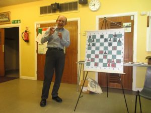 Matthew explains the theme of compactness while demonstrating Capablanca-Sergeant Hastings 1929. Photo by kind permission of Richard James